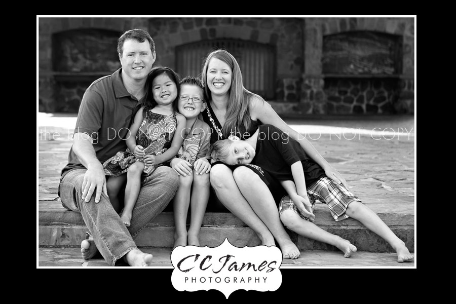 Family at the steps of a beautiful park in Houston - perfect day for photography.